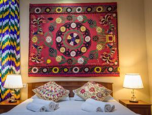 Cama o camas de una habitación en Jahongir Guest House