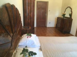 Łóżko lub łóżka w pokoju w obiekcie Decameron Apartments