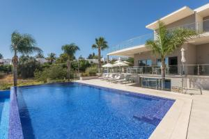 The swimming pool at or near Caneiros Luxury House & Suites