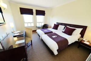 A bed or beds in a room at Glynhill Hotel