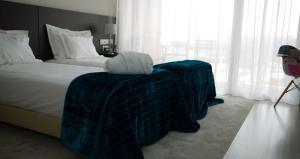 A bed or beds in a room at Casa de Campo Memórias da Comarca