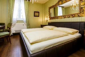 Ein Bett oder Betten in einem Zimmer der Unterkunft Hotel Palais Porcia