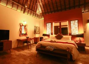 A bed or beds in a room at A Villa Gili Air