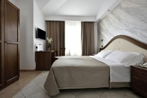 A bed or beds in a room at Hotel Nicoletta