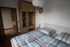 Ein Bett oder Betten in einem Zimmer der Unterkunft Ferienwohnung am Baldeneysee