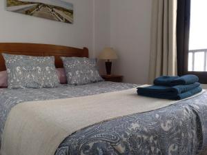 Łóżko lub łóżka w pokoju w obiekcie Francos Rooms