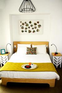 A bed or beds in a room at Crops Suites