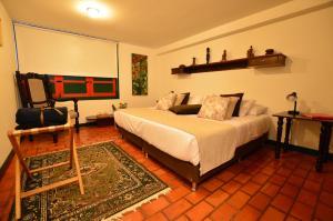 A bed or beds in a room at Reserva El Cairo - Valle de Cocora