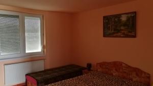 Postel nebo postele na pokoji v ubytování Apartman Taktik