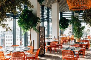 A restaurant or other place to eat at Grand Hyatt Athens
