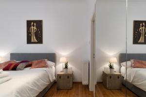 A bed or beds in a room at Cutie by Stylish Stays
