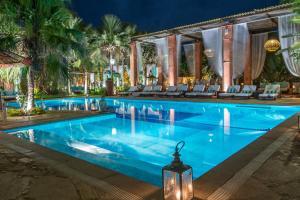 The swimming pool at or near Pedra da Laguna Boutique Hotel SPA