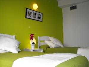 A bed or beds in a room at Hostal Santa Catalina