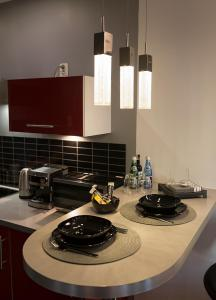 A kitchen or kitchenette at Apartament Onyx