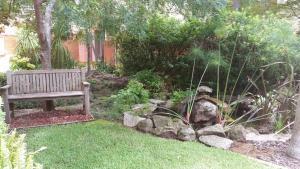A garden outside Wyndel Apartments St Leonards - Shoremark