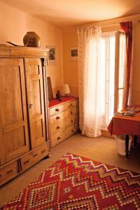 A bed or beds in a room at Chambres d'Hôtes Rue de la Paix