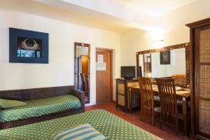 A bed or beds in a room at Hotel La Perla Del Golfo