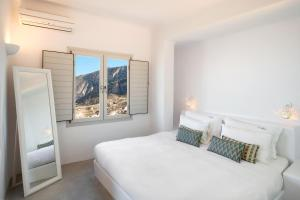 A bed or beds in a room at Skyfall Suites - Adults Only