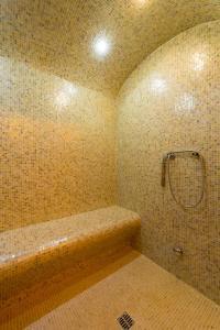 Ein Badezimmer in der Unterkunft Palazzo Bezzi Hotel