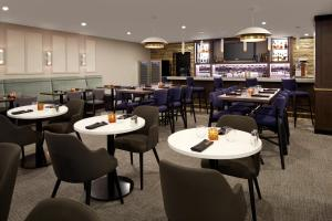 A restaurant or other place to eat at Doubletree By Hilton Montreal Airport