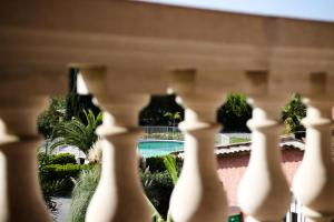 A view of the pool at Les Bastides Saint Paul or nearby