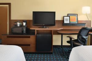 A television and/or entertainment center at Fairfield Inn & Suites Stevens Point