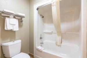 A bathroom at Super 8 by Wyndham Dallas East