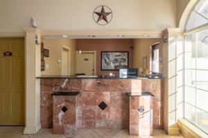 A kitchen or kitchenette at Super 8 by Wyndham Dallas East