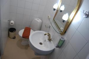 Ванная комната в Гостиничный Комплекс Буржуй