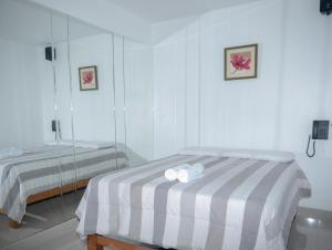 A bed or beds in a room at Hostal Sueños