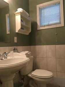 A bathroom at Westhampton Seabreeze Motel