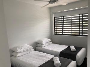 A bed or beds in a room at Quattro On Young