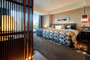 A bed or beds in a room at Hotel New Otani Tokyo The Main