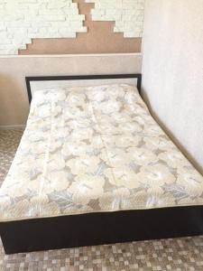 Кровать или кровати в номере Квартира на Войкова 27