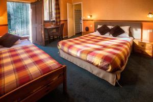 Un ou plusieurs lits dans un hébergement de l'établissement Hotel La Petite Auberge