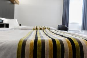 A bed or beds in a room at Littoral - Hôtel & Spa