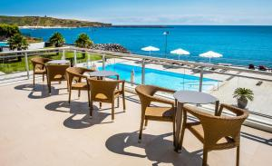 A view of the pool at Atlantida Mar Hotel or nearby