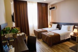 Кровать или кровати в номере Отель Олимпия