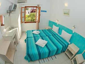 A bed or beds in a room at Villa Marina