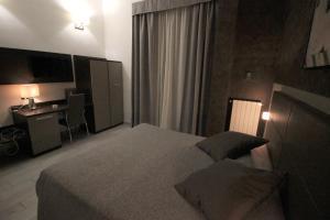 Letto o letti in una camera di Hotel Charter