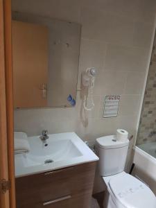 Um banheiro em Hostal Martinval