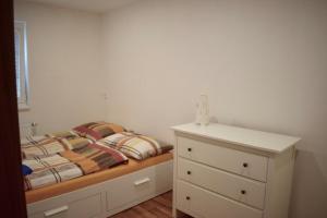 Postel nebo postele na pokoji v ubytování Penzion Chata pod sjezdovkou