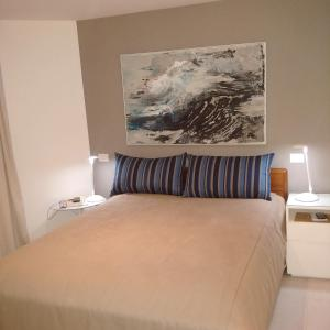A bed or beds in a room at Ocean Flat