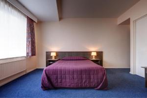 Кровать или кровати в номере Hotel Beau Site