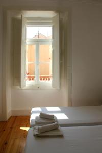 A bed or beds in a room at Tiles Square Apartments - Alfama with River View