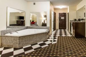 A bathroom at Evangeline Downs Hotel, Ascend Hotel Collection