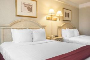 A bed or beds in a room at Clarion Hotel & Conference Centre