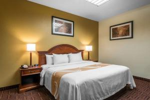 A bed or beds in a room at Quality Inn South Colorado Springs