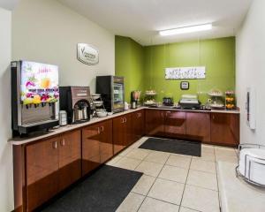 A kitchen or kitchenette at Sleep Inn & Suites Orlando Airport