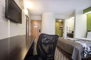 A television and/or entertainment centre at Sleep Inn Miami Airport